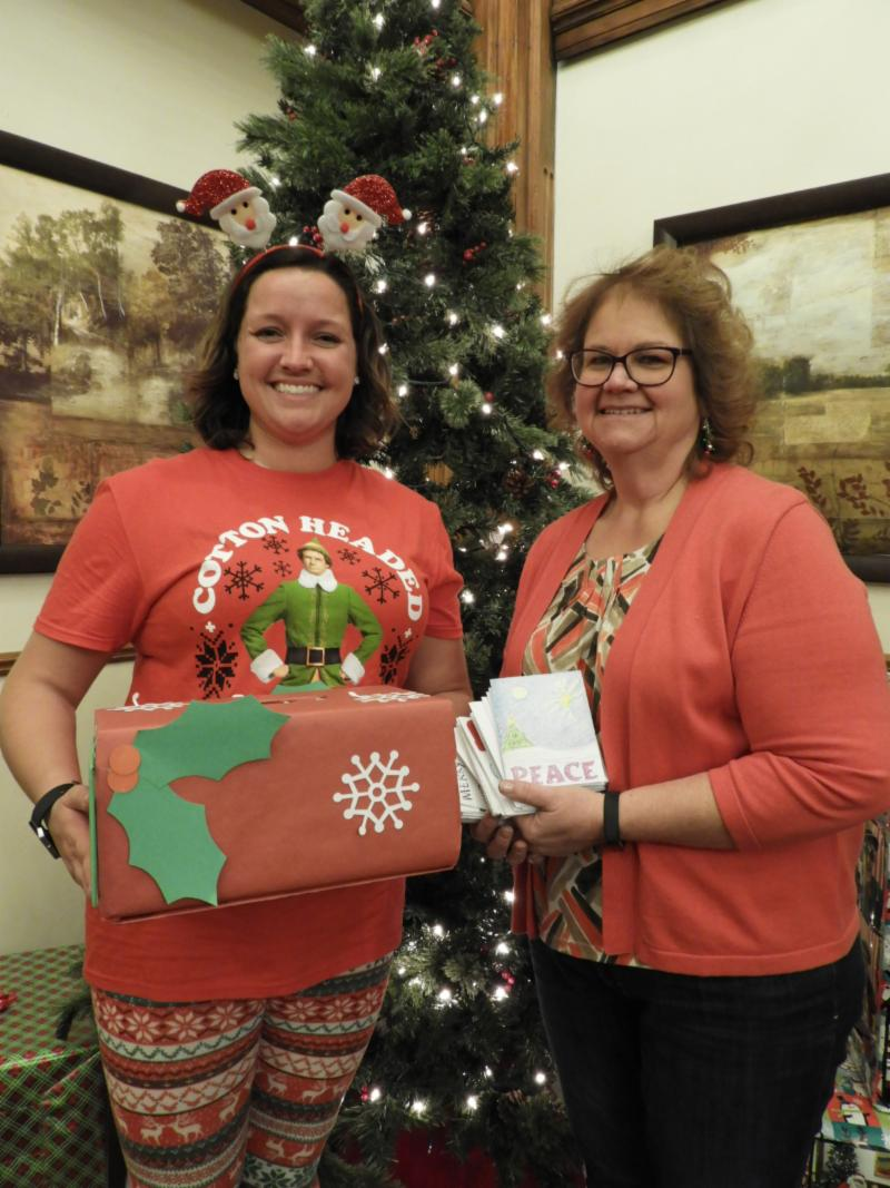 Fort Armstrong and Children Librarian with holiday cards