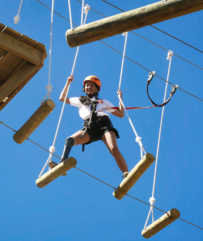 an image showing a child doing outdoor summer activities