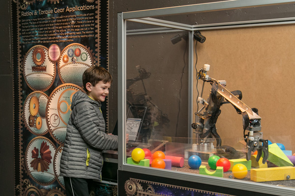 Photograph of a boy visiting Robot Revolution at Cranbrook Institute of Science.