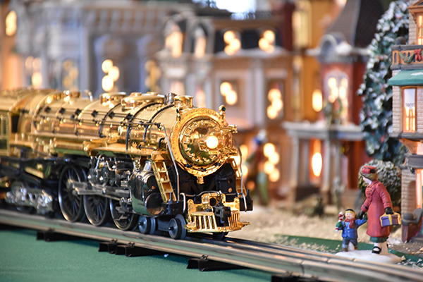 Photograph of the gold Lionel train during Holiday Splendor 2018 at Cranbrook House.