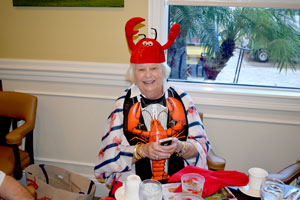 IRCC Resident wearing a lobster hat and bib
