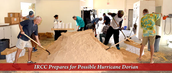 Employees and Members at Indian River Colony Club fill sandbags in preparation for the storm.