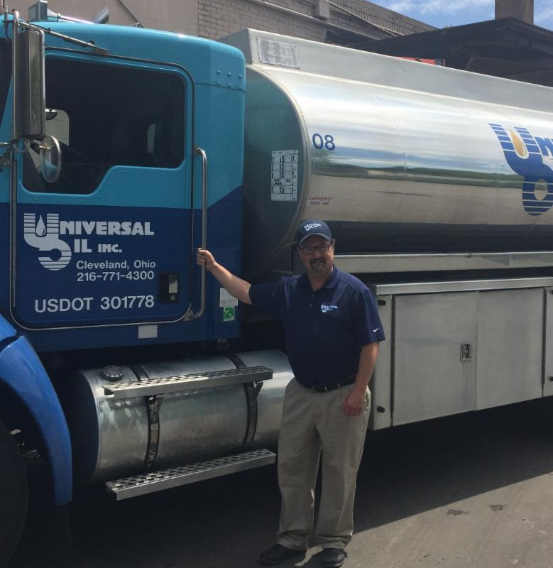 Joe Shoemaker pictured next to one of the oil trucks own by Universal Oil.