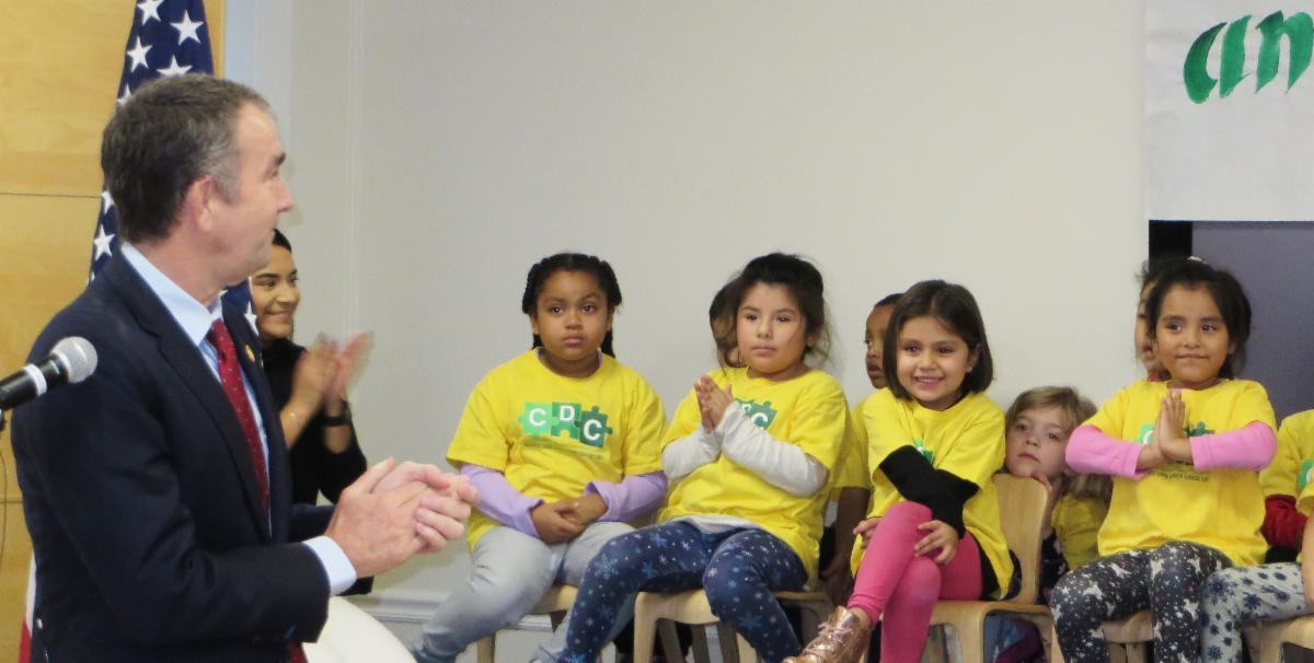 Children at the ACCA Child Development Center listen as Virginia Governor Ralph Northam presents his ideas on increasing funding for early childhood education.