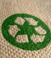 Green recycling symbol on a napkin