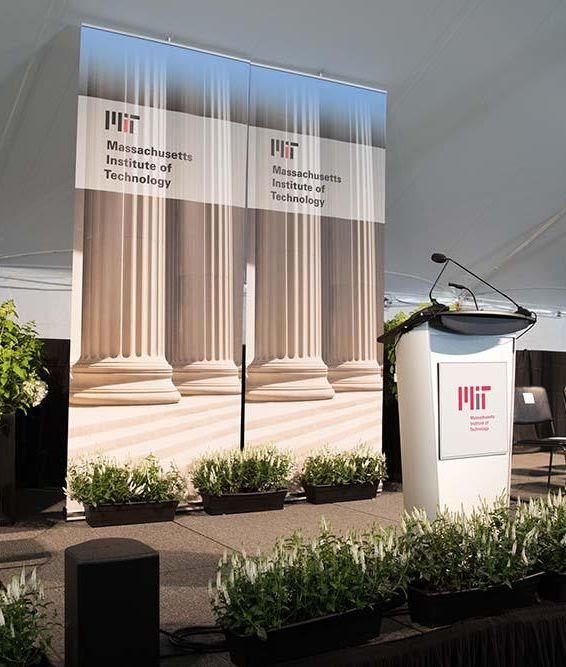 Image of MIT event stage with lectern and microphone; photo: Jake Belcher