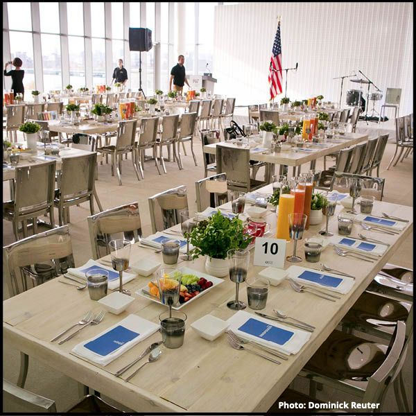 Image of an event setup in the Media Lab: Tables set for a group lunch
