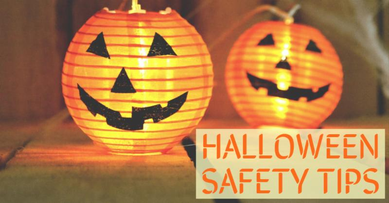lit-up pumpkins with text that says halloween safety tips
