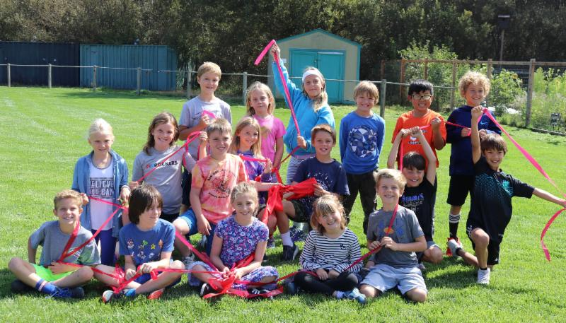 Tam Valley 3rd Grade students on the new field with the ribbon