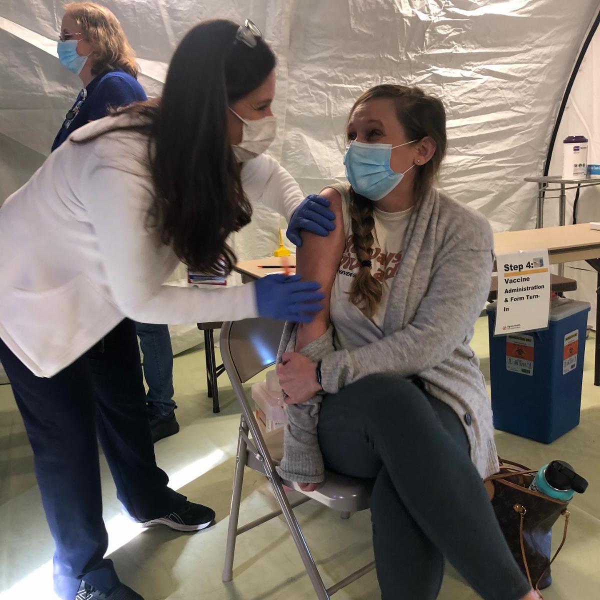 Megan Babb DO receives her vaccine
