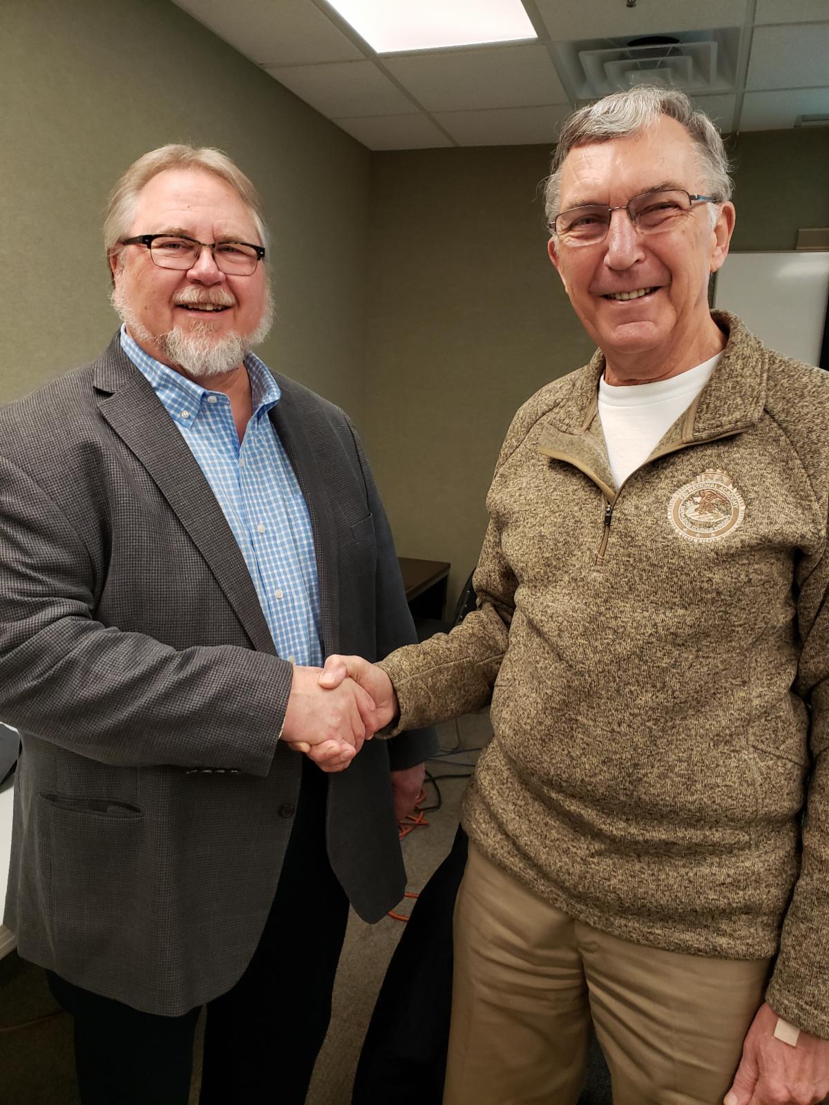 BACC President Dave Wegge thanks retiring Board member Tom Hinz
