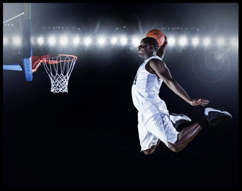 Basketball Player scoring an athletic_ amazing slam dunk