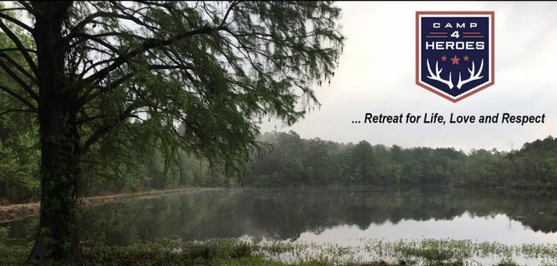 Image of lake surrounding camp, dense trees,