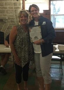 Barbara Brewton accepts award