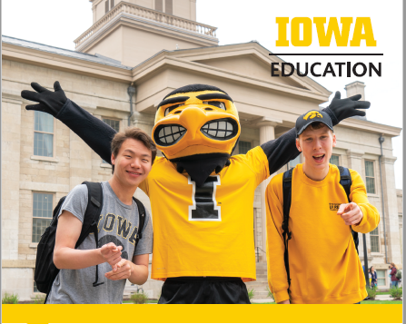 Two male college students with Hawk mascot. All are in grey_ black_ and yellow_ University of Iowa colors. The words Iowa and Education appear in the upper right corner.