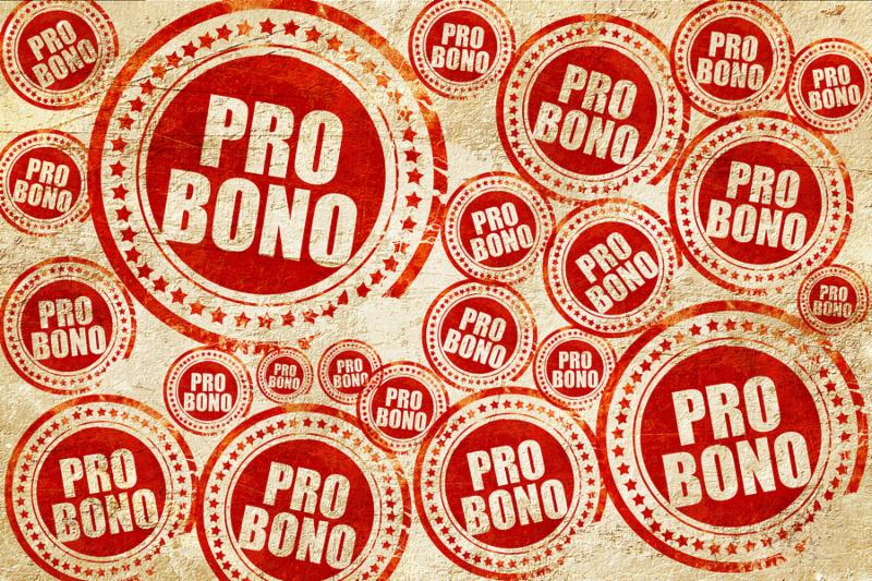 pro bono_ red stamp on a grunge paper texture