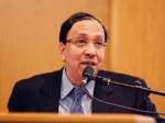 Sugata Bose in front of a microphone