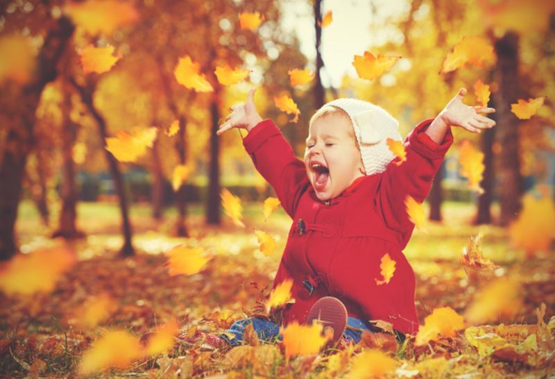 happy_baby_in_leaves.jpg