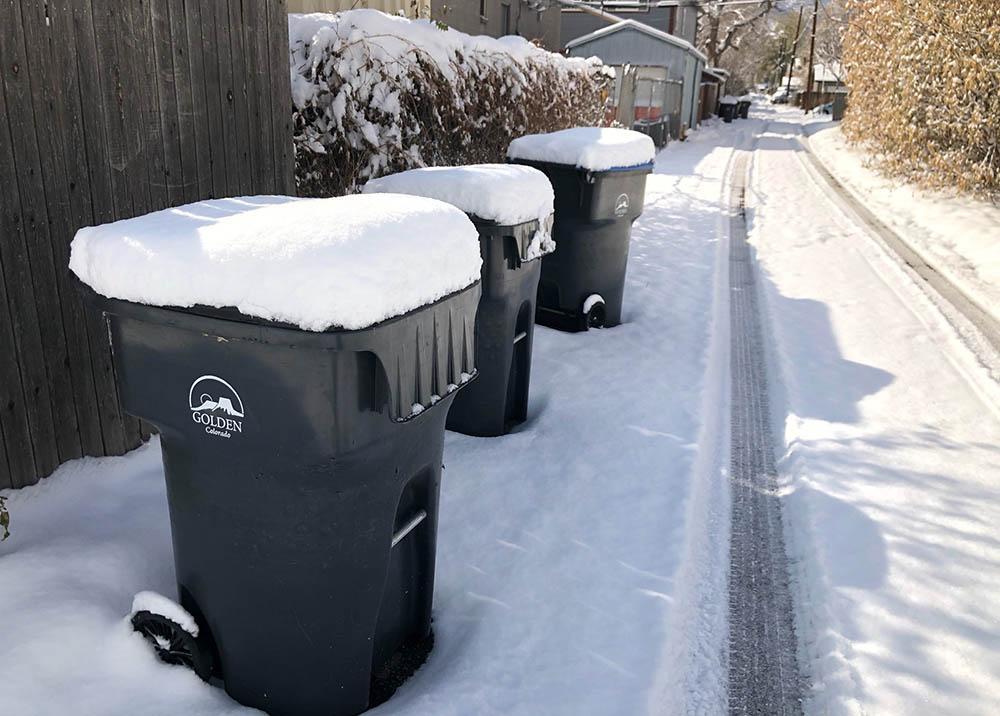 snowy trash cans