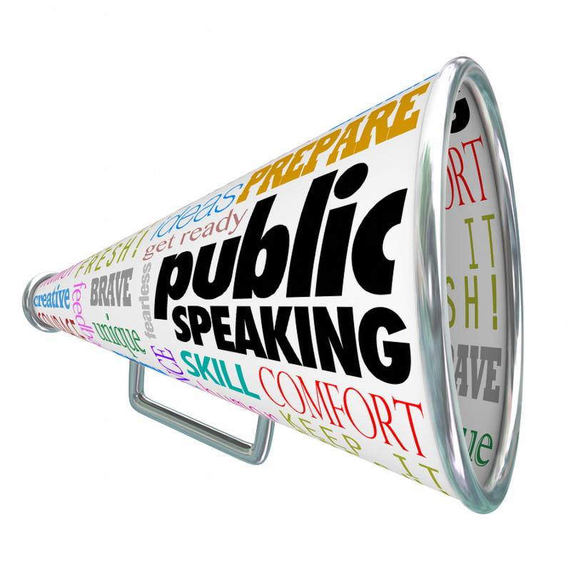 Public Speaking words on a 3d bullhorn or megaphone offering advice_ tips or expert training on delivering a speech at an event or meeting