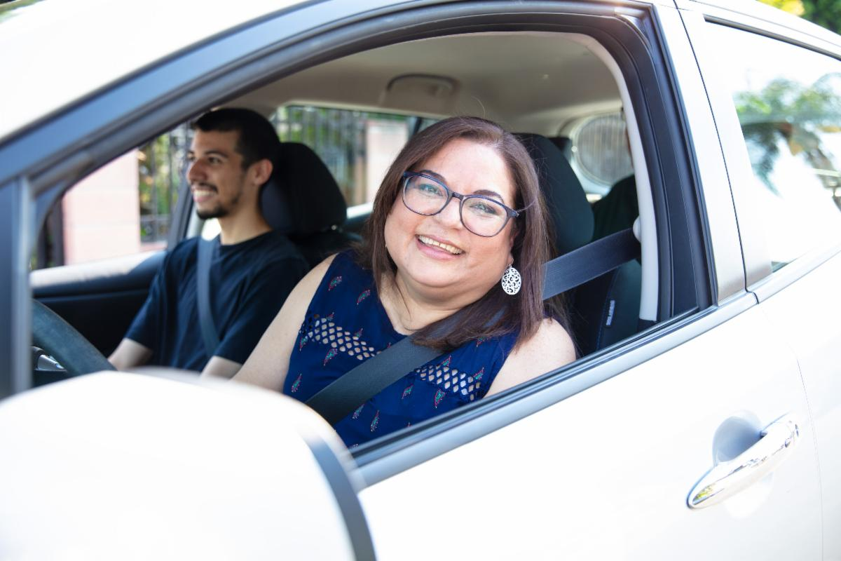 Woman driving vehicle.
