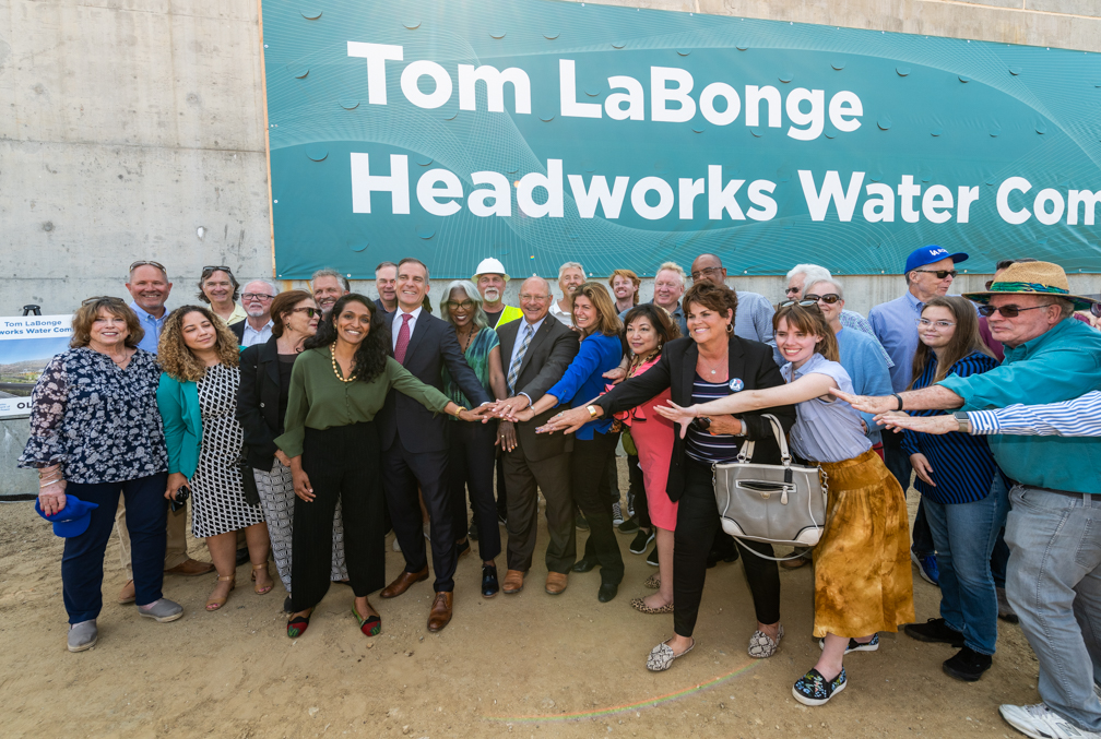 Image of a group of people in front of a banner that reads Tom LaBonge Headworks Water Complex