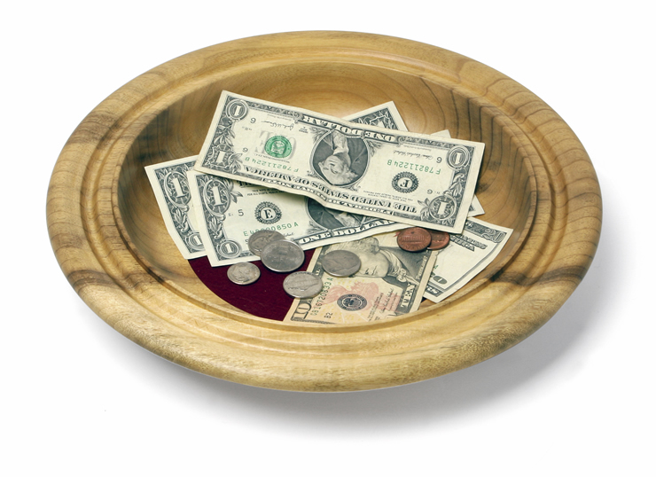 A collection plate with money