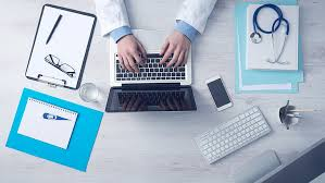 Medical professional using a laptop