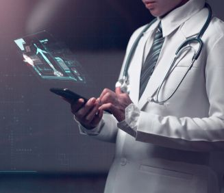 doctor holding smart device with human anatomy graphic showing