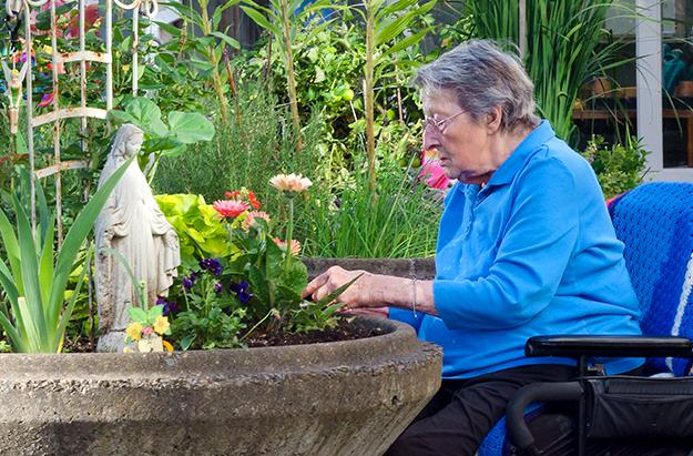 A woman in a chair gardening