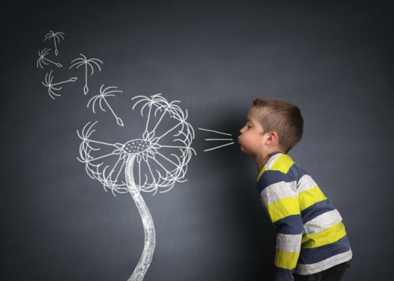 child_blowing_dandelion.jpg