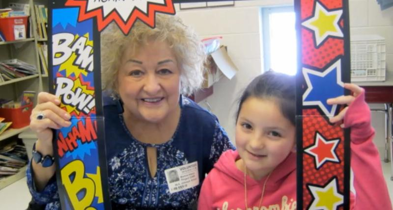 Photo of a Project CARE mentor and a student smiling for a photo