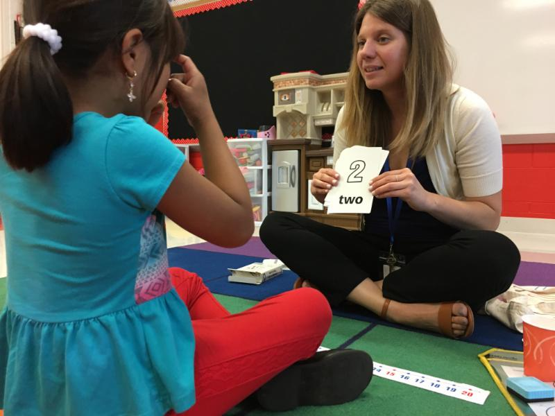 Photo of BSD2 Math Specialist Kristi Mullen working with a student