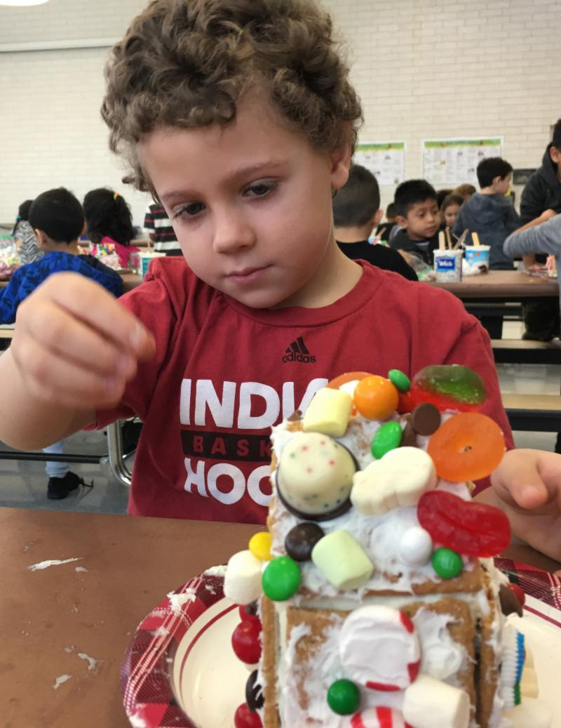 Photo of Johnson kindergartner building a gingerbread house