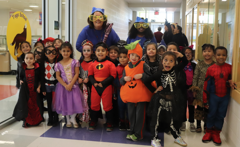 Photo of students marching in Tioga School's Halloween Parade