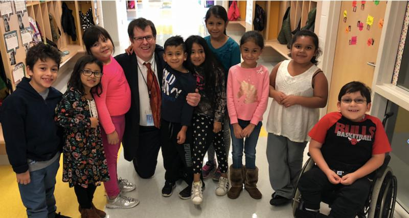 Photo of BSD2 Superintendent Doctor Jim Stelter with a group of Tioga students