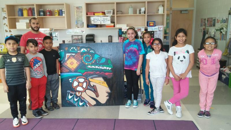 Photo of Johnson students posing with the art they created in Frida Kahlo's after-school program.