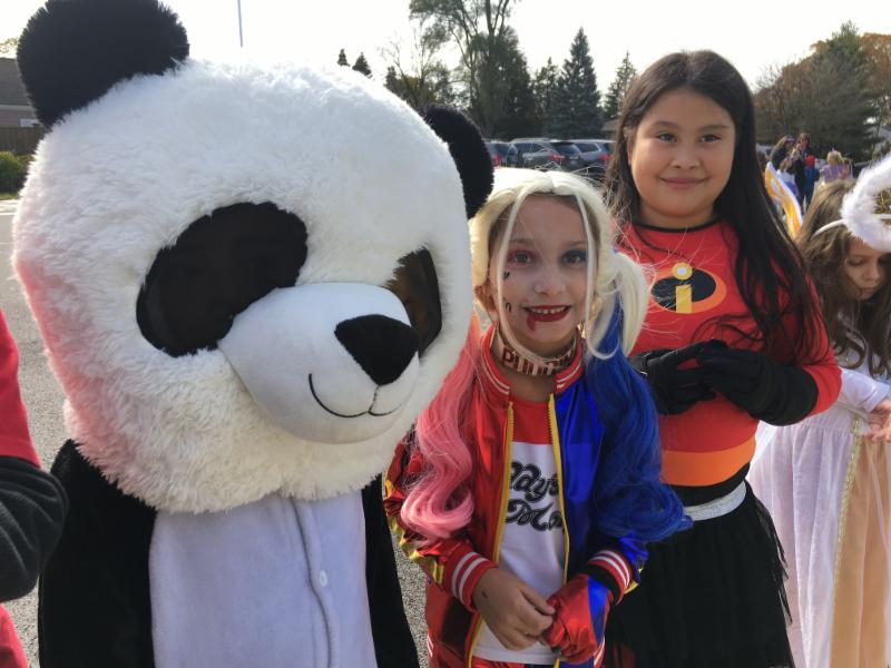 Photo of students marching in Johnson's Halloween parade