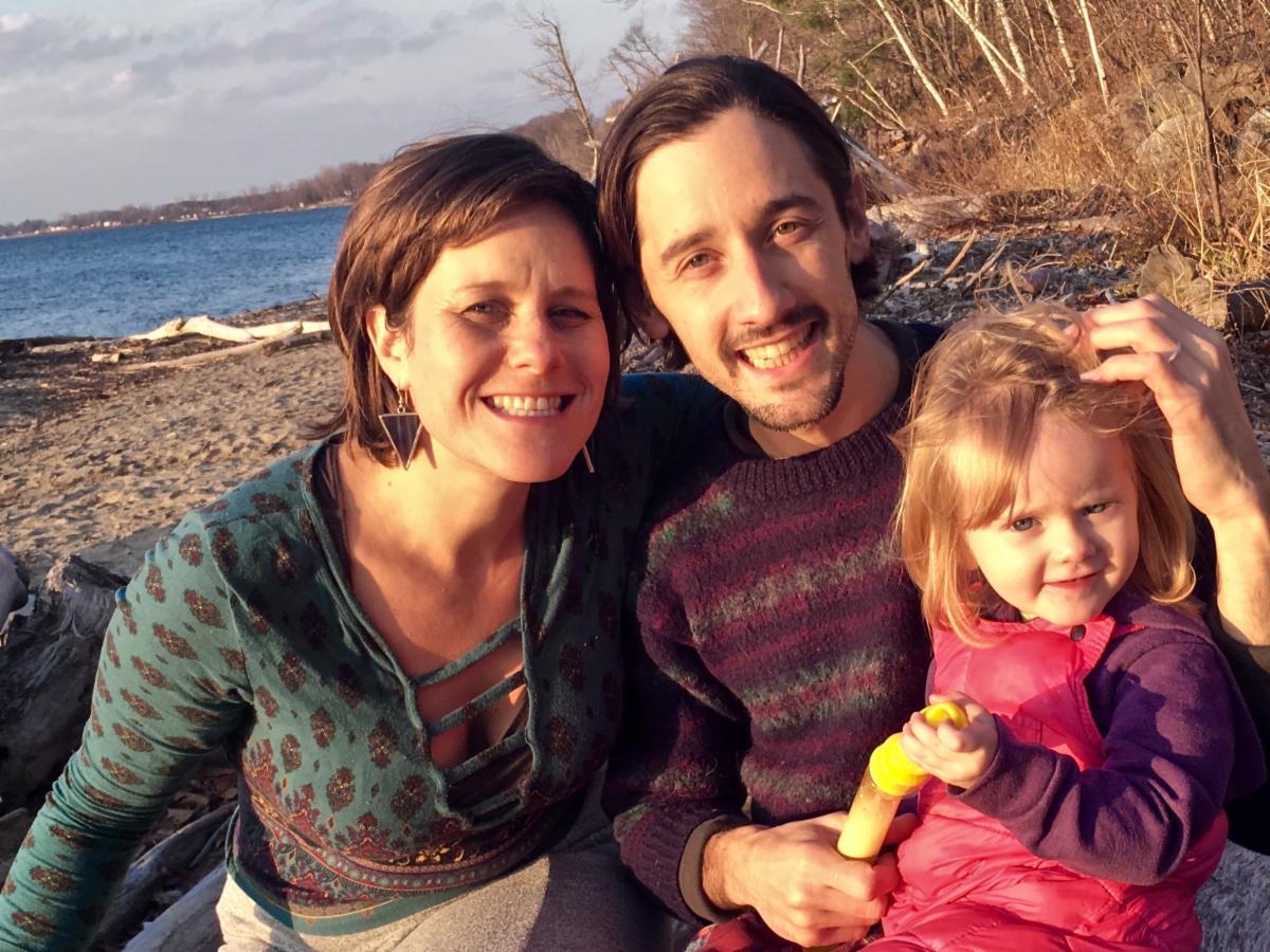 Lauren Larken Scuderi with her partner and child
