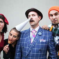 Vermont Vaudeville performers gathered together making faces at the camera