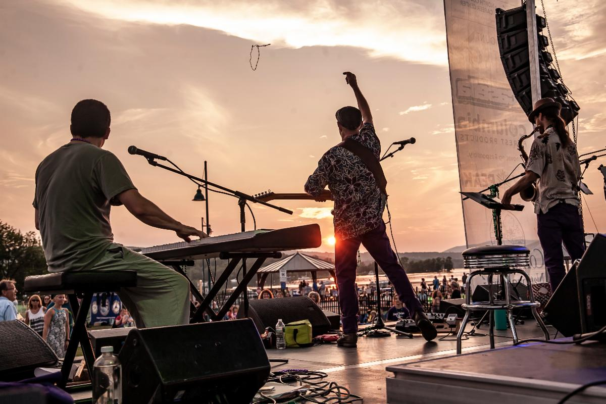 Musicians play onstage at sunset at a Catamount Arts summer concert in 2019