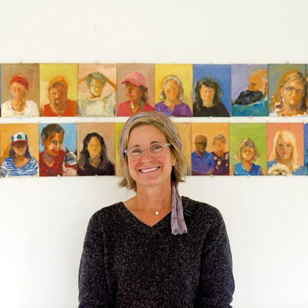 Rebecca Kinkead standing in front of her artwork