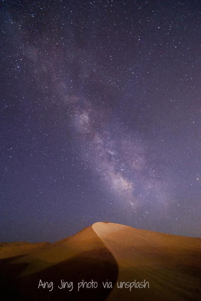 Ang Jing sand dune under milky way via unsplash