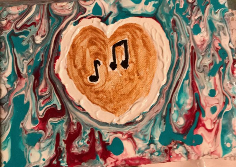 Painting with musical notes in gold heart