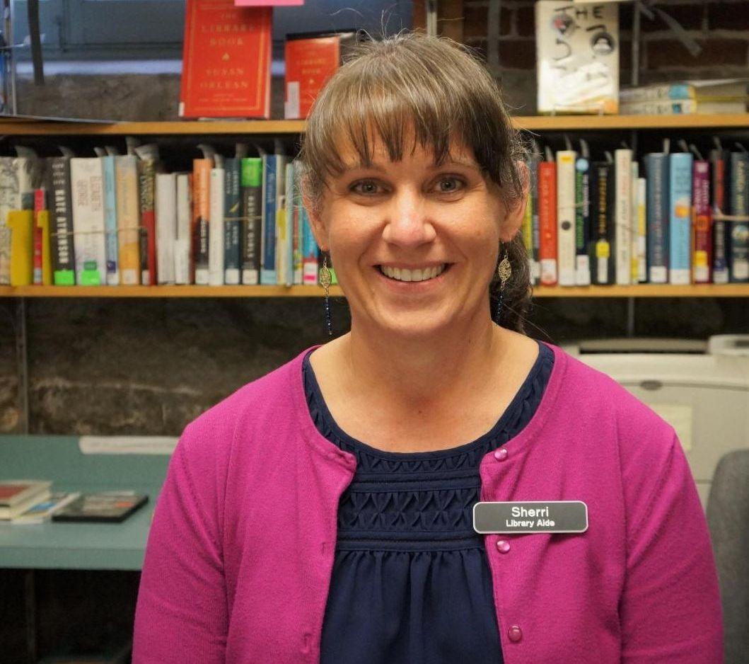 Sherri Larson at circulation desk