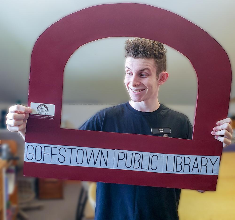 Kyle poses with his library card and the selfie cutout for September
