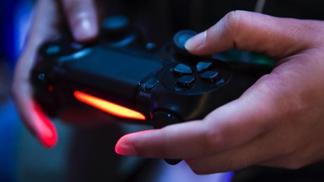 Close up of hands holding a gaming controller
