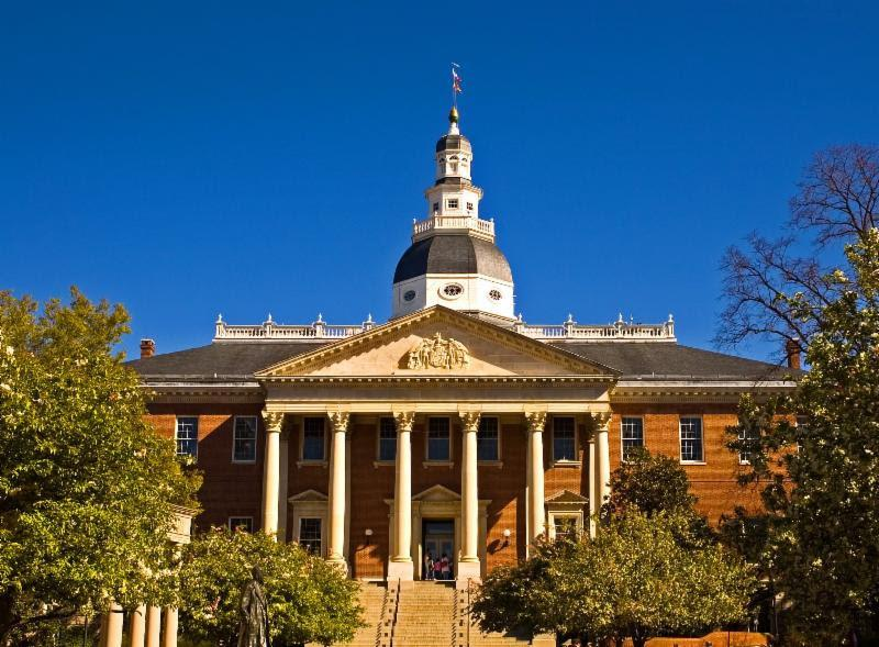 Image of MD State House with Blue sky in background and trees in foreground