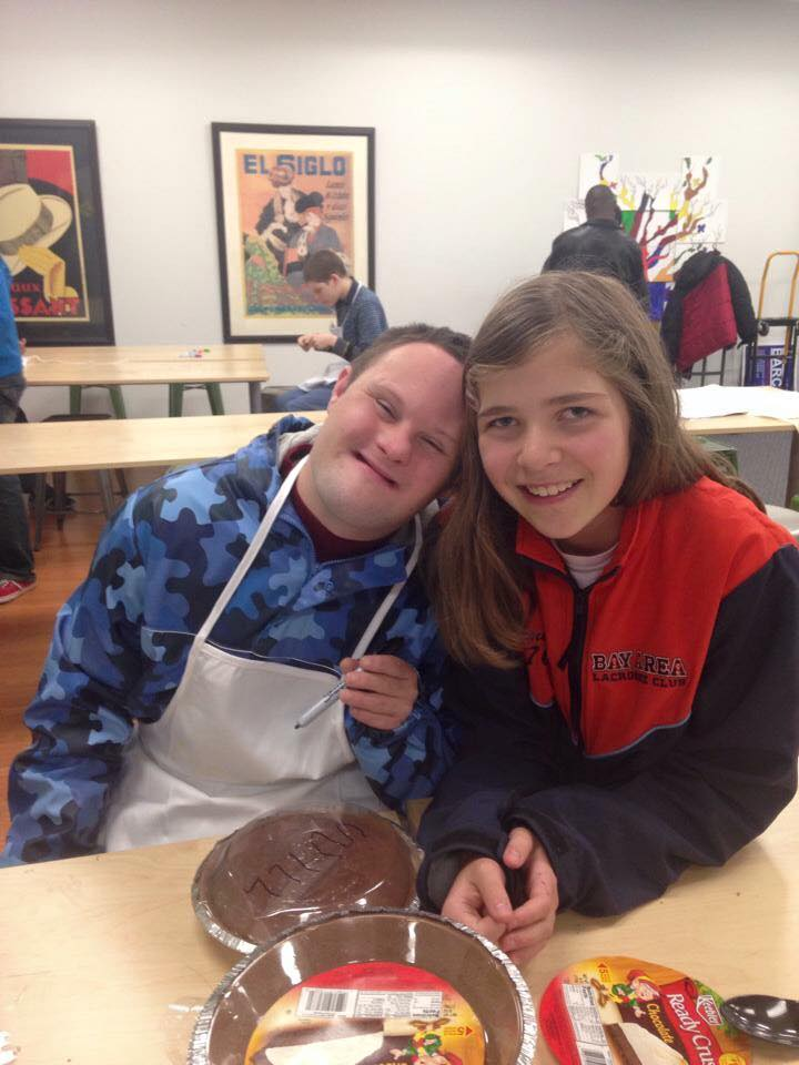 Man with Down Syndrome smiling with young girl