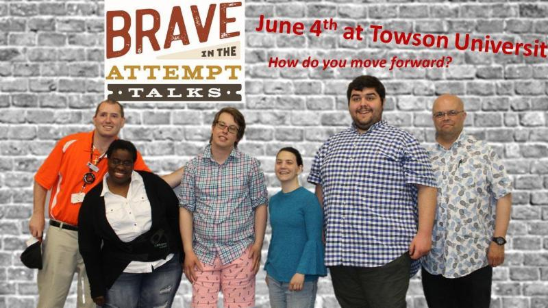 Group of six stand in front of wall with _Brave in the Attempt June 4th Towson University_ behind them.